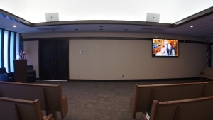 """Greenwood Memory Lawn Chapel in Phoenix uses two JBL Control 30 commercial speakers and a Sharp 70"""" flat screen TV."""