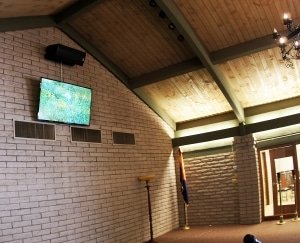 """Chapel of the Chimes Mortuary in Glendale main chapel with 65"""" flat screen TV and SLS 8290 speaker."""
